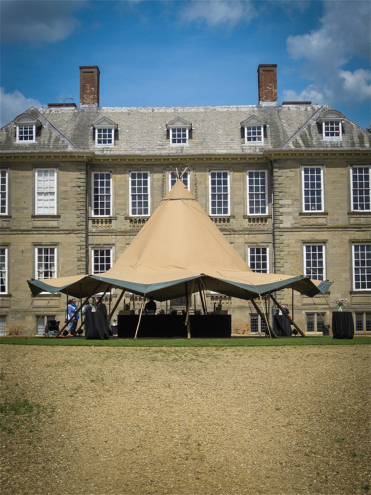 Tipi set up in front of a stately home
